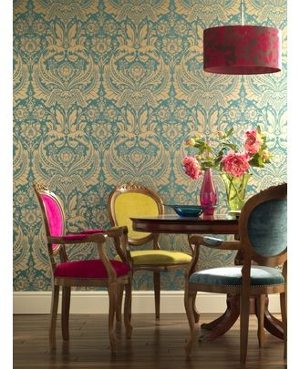 Traditional elements combine with bright colors to form a more modern, funky overall look: I love the wallpaper, the chandelier, and how each of the matching chairs is upholstered in a different color fabric.