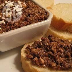 This Caper and Olive Tapenade is great spooned onto pizza with goat cheese and rocket. @ allrecipes.com.au