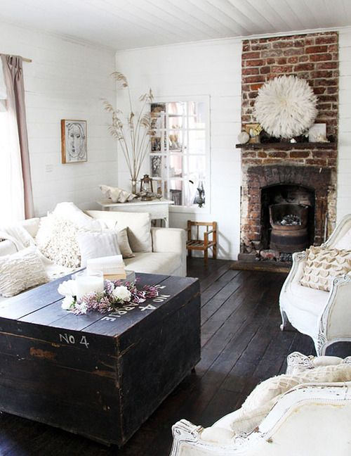 Sigh, brick fire place and white wood paneled walls with amazing chairs and an amazing stained crate coffee table?! My. Dream.