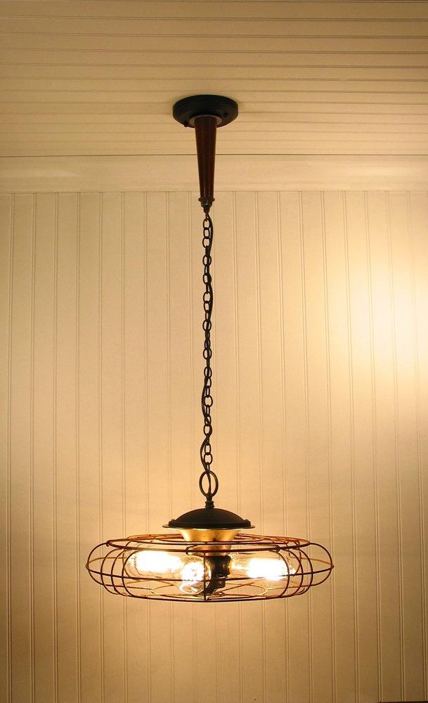 Vintage fan turned light fixture. Amazing/unique light fixtures. Etsy shop.
