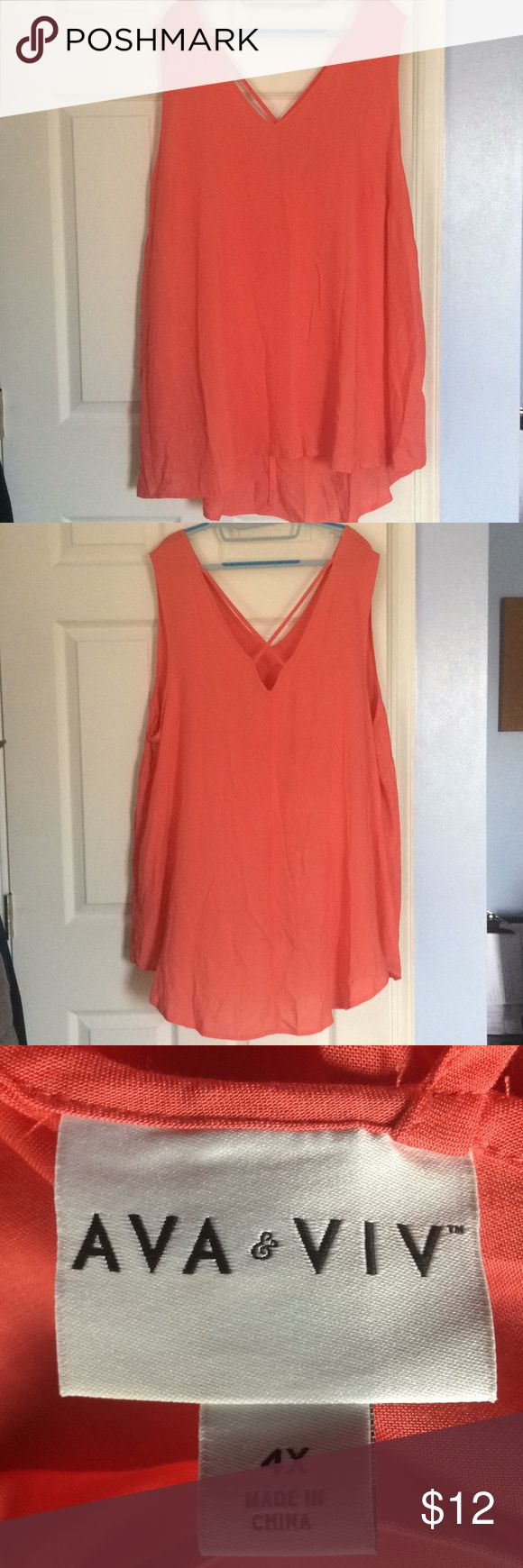 Ava & ViV Orange strappy back Tank Top Barely worn plus sized Ava & Viv orange strappy back tank top in a size 4X. Great piece to be worn as a Layering piece or during those long warm summer days. Fabric makeup is the last pic. Bundles and offers are always welcome. HAPPY POSHING POSHERS Ava & Viv Tops Tank Tops