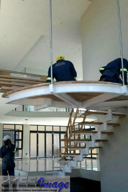 Our guys hard at work finishing up this custom designed staircase  #steelimage #mildsteel #staircase #design