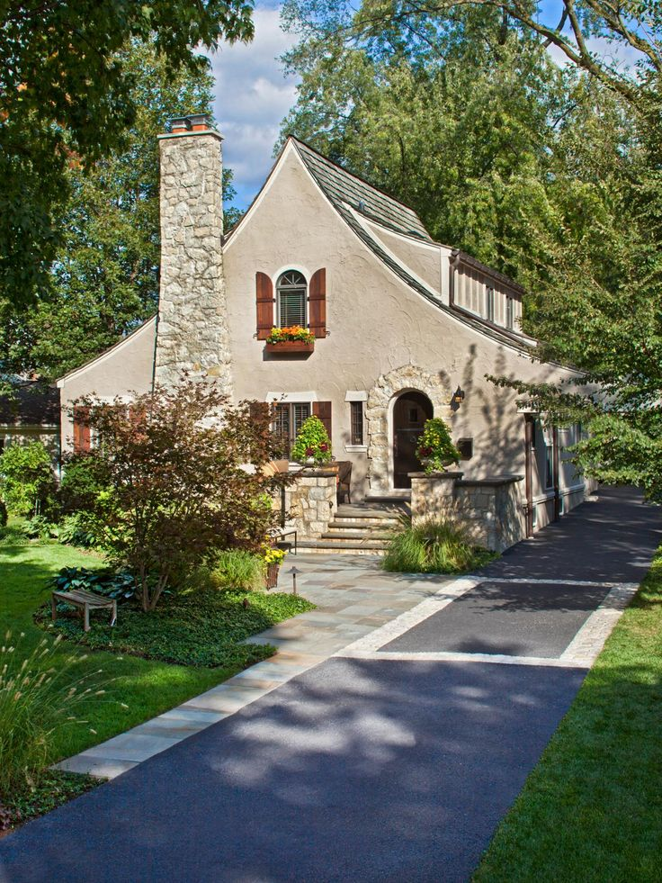 This quaint stone cottage has a welcoming old world feel with rustic wooden shutters window - Wood and stone house plans a charming symbiosis ...