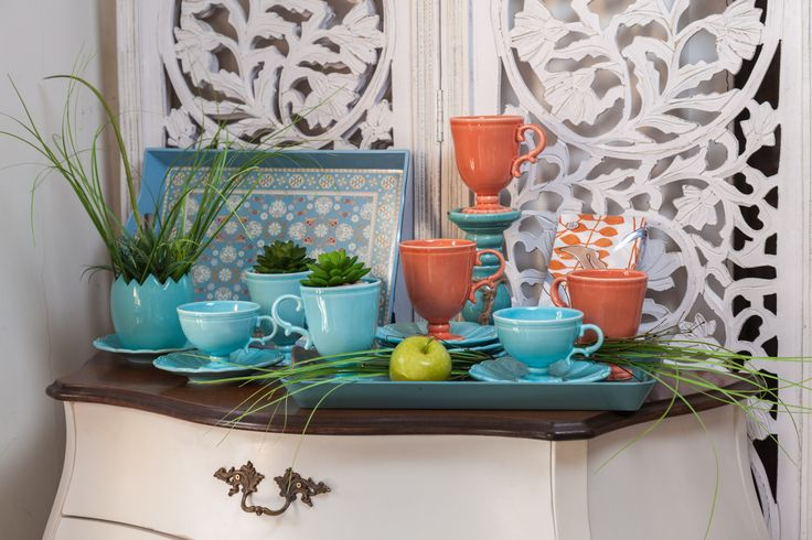 Oranges in the shape of mugs placed on turquoise plates. The contrast between them will lift you and your house's spirit. Imagine placing succulents in their ribcage, drinking Orange & Cinnamon tea from them, and watching candles burning slowly in these darkest moments.