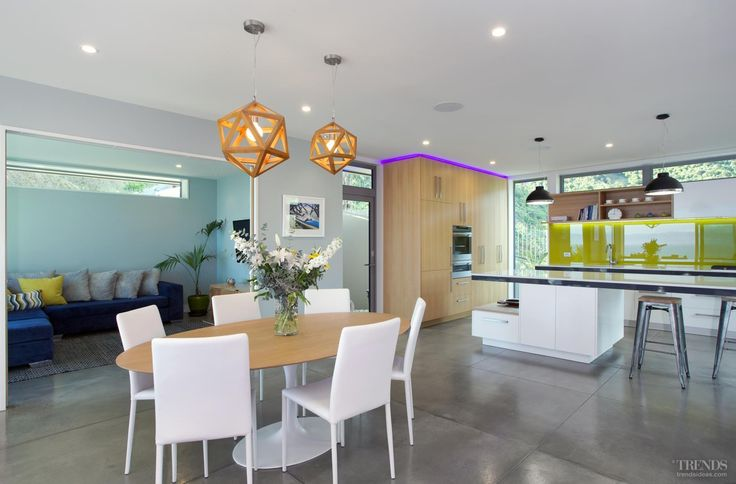 The interiors are calm and understated, with pops of vibrancy coming from colour-changing LEDs around the cabinetry and a backpainted glass splashback.