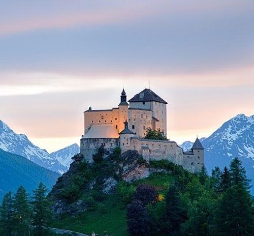 Tarasp Castle,  Lower Engadin, Graubünden, Switzerland....     http://www.castlesandmanorhouses.com/photo.htm    ....    Chastè da Tarasp (Tarasp Castle or in German, Schloss Tarasp) sits on a hill top near Tarasp. Located in the Romansh speaking area of Switzerland, it is a Swiss heritage site of national significance.