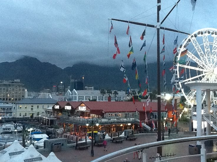 V&A Waterfront on a cold evening. Cloud over Table Mountain in the background.
