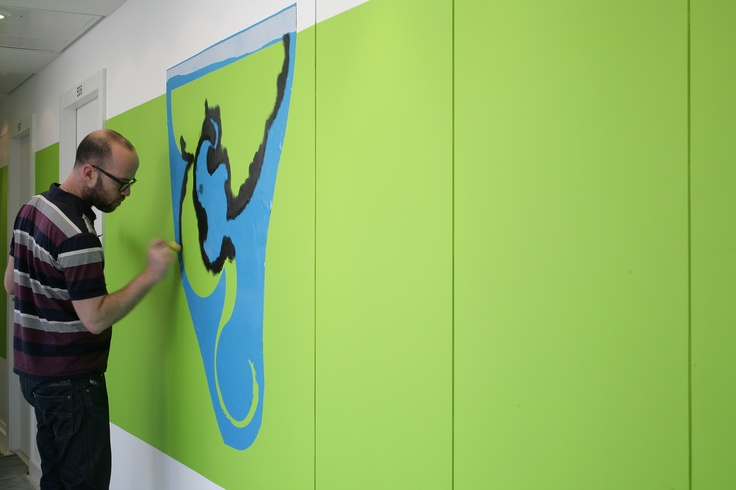 Doron Rabina working on his wall piece for the 5th floor of the Art Plus Hotel. www.atlas.co.il