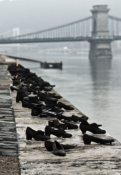 During WWII, Jews in Budapest were brought to the edge of the Danube, ordered to remove their shoes, and shot, falling into the water below. 60 pairs of iron shoes now line the river's bank, a ghostly memorial to the victims. | 'Shoes on the Danube Promenade' by Can Togay and Gyula Pauer