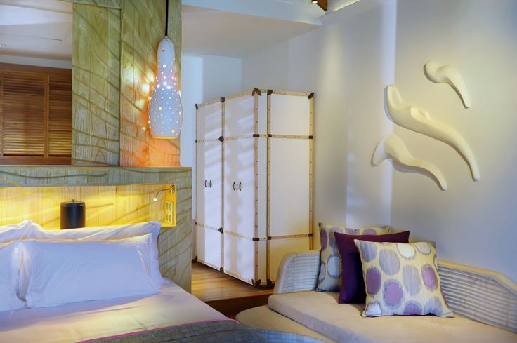 Bedroom with White Pillows White Bed Linen and White Colored Cupboard