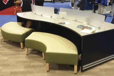 The Collaborative Work Station combines ARC Benches with legs available with caster or glides and the eight-position WAVE Table, featuring PVC edges, acrylic dividers, ample workspace, complete power distribution, and wire management systems.