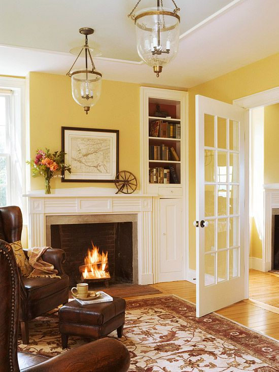 White millwork, soft yellow walls, honey wood floors, cognac leather wing chairs: this is my Dream Room!!