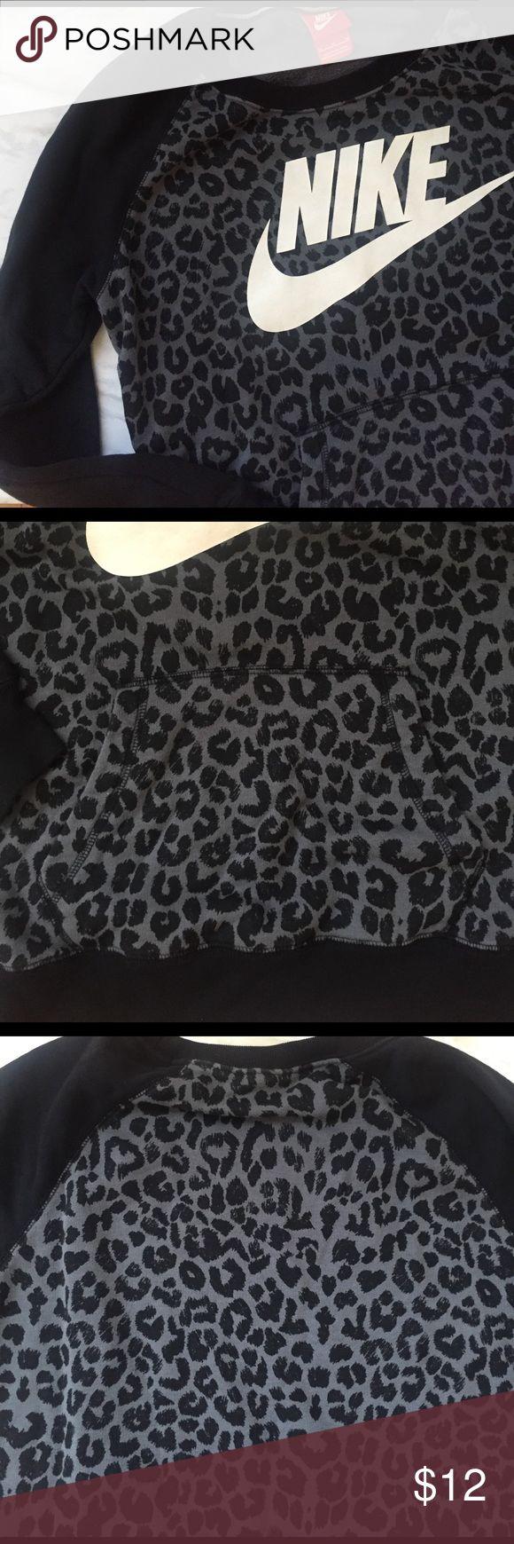Nike Leopard print sweatshirt Crewneck Black + grey leopard print and black solid arms with Nike in white font on front.  Large front pocket. Size medium and TTS Nike Sweaters Crew & Scoop Necks
