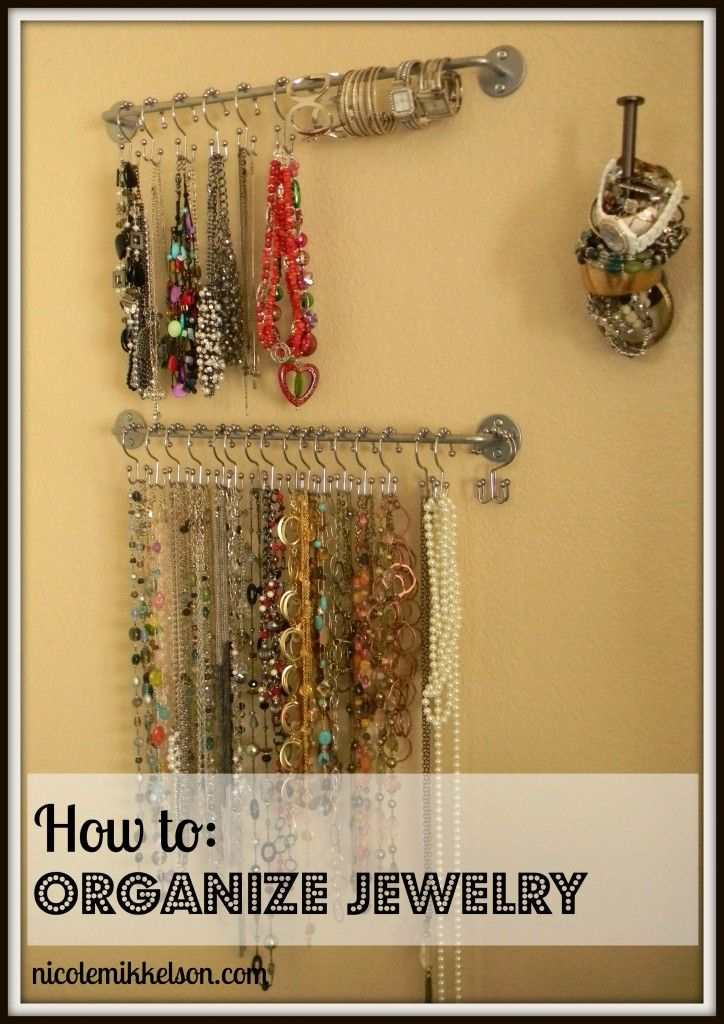 jewelry organization or you could hang tank tops like this as well - Think I might mount one to a weathered piece of wood to hang from the wall.  Nice idea.