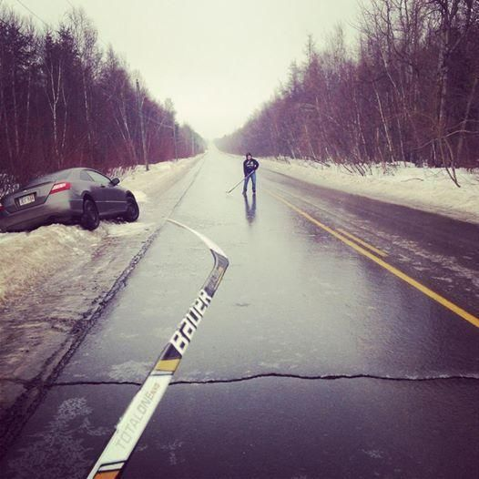 Only in Canada . The roads are so icy, they played hockey while waiting for the tow truck to arrive.