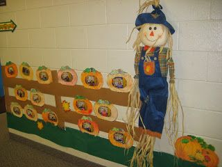 A cute fall decoration for elementary school.  The pumpkins have the students' faces on them.