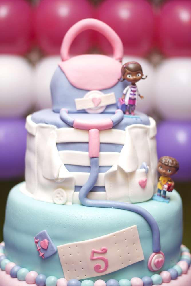 Very fun cake at a Doc McStuffins birthday party! See more party planning ideas at CatchMyParty.com!