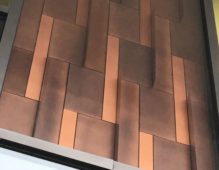 The photo represents Modularity principle. This wall is designed in a modular way, which makes it easy install and replace incase of damages, and it's also flexible to change, and easy to maintain.