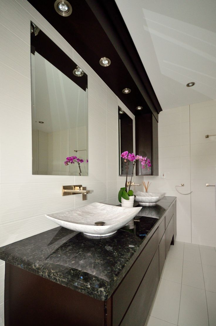 custom vanity with granite counter top top mount vessel sinks and wall mounted faucets