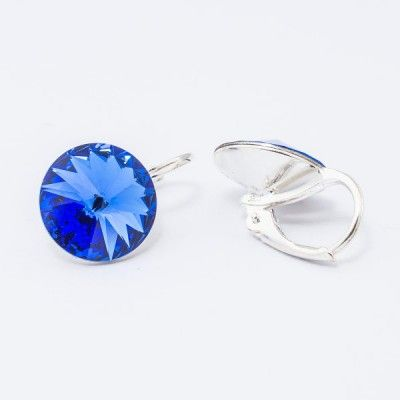 Swarovski Rivoli Earrings 12mm Sapphire  Dimensions: length: 1,7cm stone size: 12mm Weight ~ 3,18g ( 1 pair ) Metal : silver plated brass Stones: Swarovski Elements 1122 12mm Colour: Sapphire 1 package = 1 pair Price 16,90 PLN(about 4 EUR)