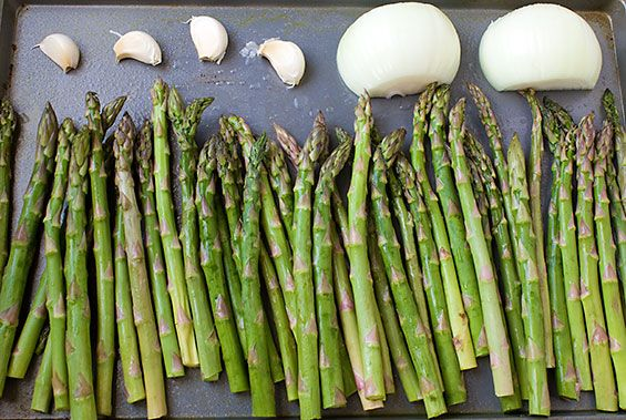 Creamy Roasted Asparagus Soup ... 2 lbs asparagus, 1 large yellow onion, peeled and halved, 4 cloves garlic, not peeled and left whole,  2 Tbsp. olive oil, 5 cups chicken broth 1/2 tsp. dried thyme, 1/2 cup milk substitute, squeeze of fresh lemon juice salt and freshly ground black pepper