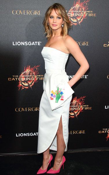 Who: Jennifer LawrenceWhat: Christian Dior dress, Chopard jewelry, and Jimmy Choo shoesWhere: The Hunger Games: Catching Fire partyWhen: May 18, 2013