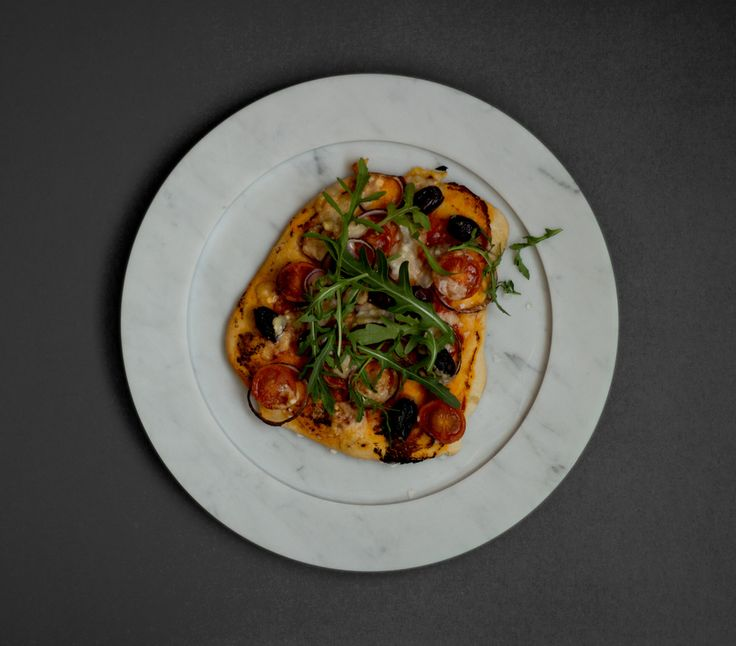 Pizza on marble plate from Stenhuggardottern. — #Marble #Plate #Pizza