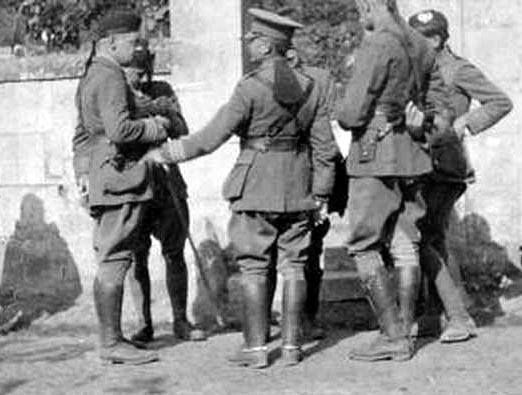 Proudly wearing the Flash, Lt-Col Henry Delme Radcliffe 2nd Bn RWF after church parade talking to men of the Cameronians (Scottish Rifles) at Septmonts on 4th October 1914.