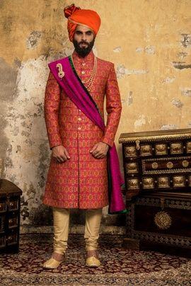Groom Wear - Coral Brocade Sherwani with Gold Chudidar and Magenta Green Dupatta, Gold Haar and Orange Pagdi | WedMeGood