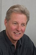 Bruce William Boxleitner (born May 12, 1950) is an American actor, and science fiction and suspense writer. He is known for his leading roles in the television series How the West Was Won, Bring 'Em Back Alive, Scarecrow and Mrs. King (with Kate Jackson), and Babylon 5 (as John Sheridan in seasons 2–5, 1994–1998). He is also known for his role as the eponymous characters, Alan Bradley/Tron in the Walt Disney Pictures film Tron, a role which he reprised in the 2010 sequel, Tron: Legacy