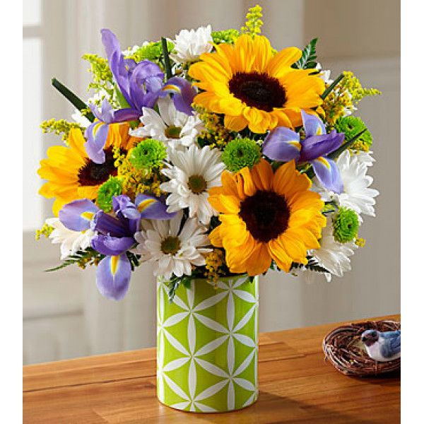 As fresh, joyful and colorful as the season, these lovely mixed flowers shower any occasion with a burst of springtime loveliness. The bouquet is a sunny collection of contrasting and complementary blooms ... golden #sunflowers, blue #irises, white #daisy pompoms and more. Corporate #Flowers #Delivery to #USA