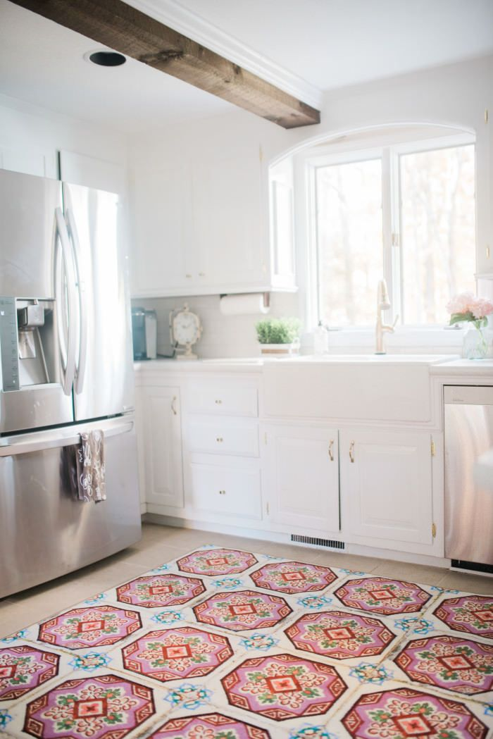 Farmhouse Kitchen Makeover // Our dark and dreary kitchen was made over to be light and bright! Farmhouse Kitchen featuring neutral tones and wood beams! // White Kitchen with Wilsonart Laminate Counters