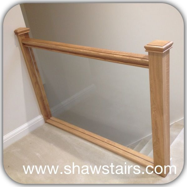 Oak balustrade with solid glass balustrade