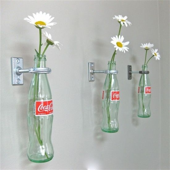 Good idea for our old bottles! Hang them on my fence! Crafts Using Glass Coke Bottles | Crafts Using Glass Coke Bottles - Bing Images