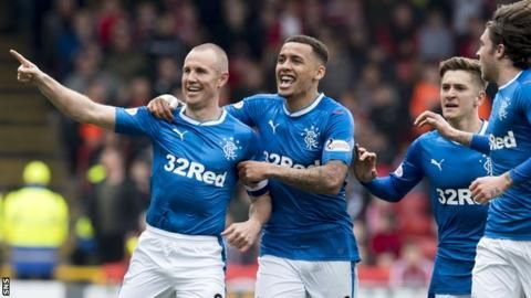 Rangers scored three times in five late second-half minutes to end second-place Aberdeen's run of 10 consecutive home wins and cut the gap to nine points.