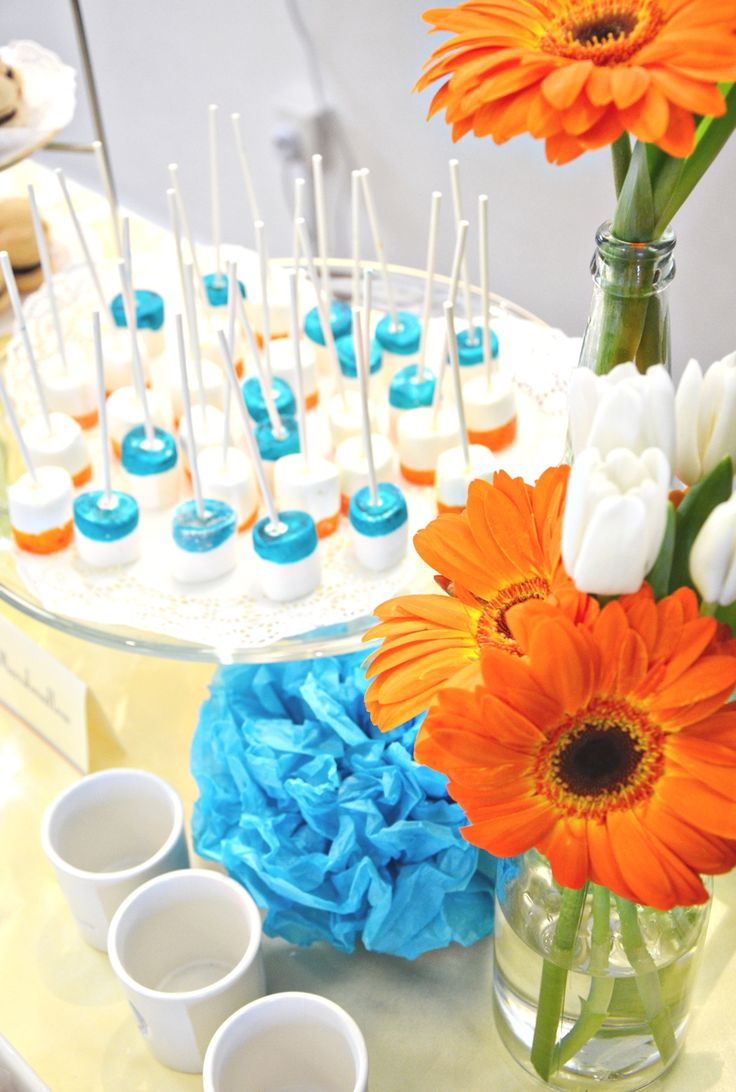 Orange & Blue Table Styling. Desserts ranging from Creme Brulee, Macarons, Marshmallow, Meringues, Tarts and Mini Cupcakes.