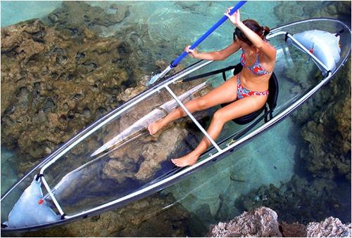 Transparent, probably fiber glass made kayak    cool