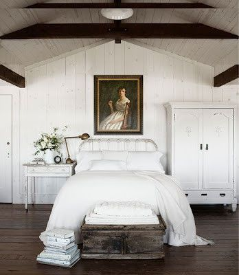 Simplicity of all white bedding with touches of gold.