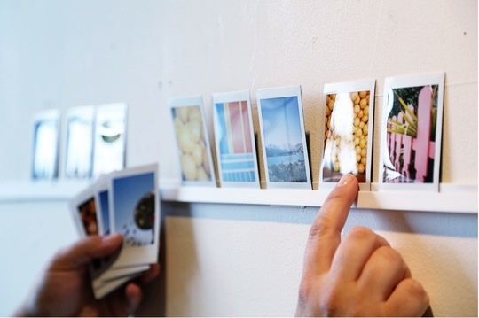 how to make any picture look like a polaroid. and Then use plastic cap molding on wall to hold them. Instant gallery!