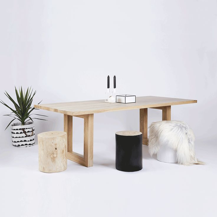 The Bondi Rectangular Dining Table is crafted in a Solid American White Oak wooden and timber top and legs. Featured here with our solid elm log tree trunk stools and By Lassen Frame Storage Box and White Kubus 4 Candleholder. All available in our online store.