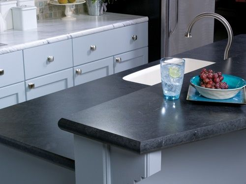 Wilsonart Calcutta Marble and Black Alicante crescent edges