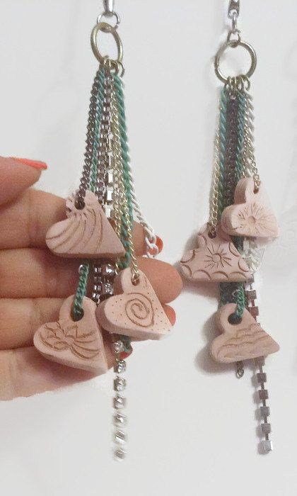 Our beautifully carved and kiln fired tan hearts come on a tasselled latch clasp key chain that doubles as an aromatherapy car diffuser. This listing includes your a choice of 2 ML essential oil in a dropper bottle. Makes a great stocking stuffer, secret santa gift, locker, dresser drawer or closet charm keeping those tight enclosed areas smelling fresh. Each hand carved heart piece is unique so no two charms are exactly alike and may not be what is in the pictures. Choose from the following…
