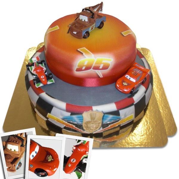 Cars  2 – Lightning McQueen,  Francesco Bernoulli und Mater auf zweistöckiger Rennstrecke-Torte mit Band – ab 74,90€