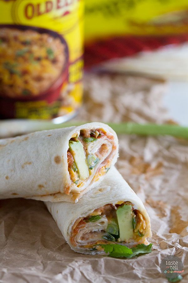 These Vegetarian Wraps with Beans and Cheese make the perfect grab and go lunch.  Filled with cream cheese, refried beans, cheese, salsa, green onions, cilantro and avocado, they will make your taste buds happy!