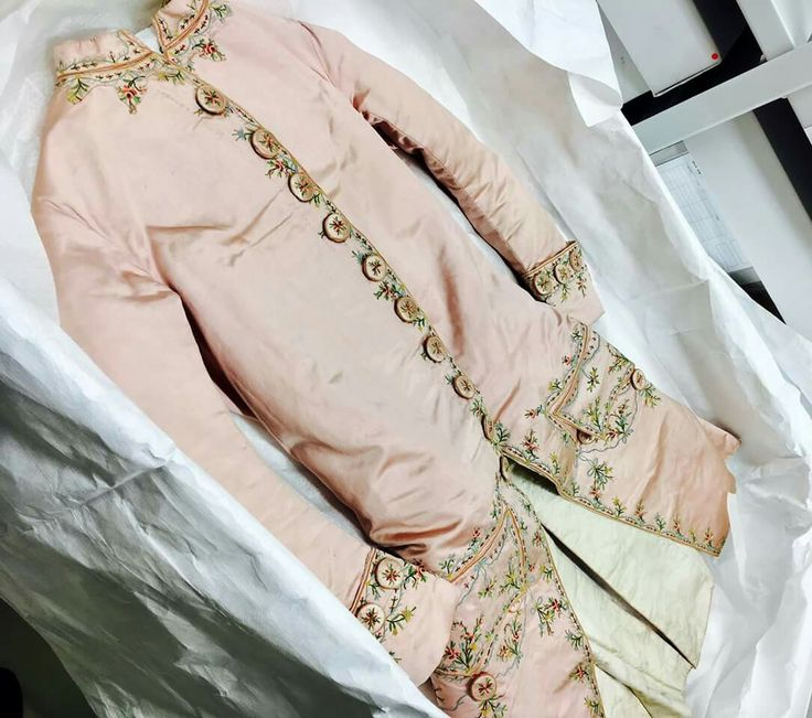 Court suit, c.1780. Pale pink silk satin with embroidery.