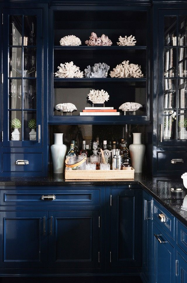 Love the dark glossy cabinet & black counter . Home Tour: A Preppy Connecticut House With Ladylike Details via @domainehome