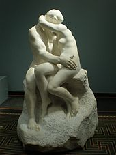 The Kiss is an 1889 marble sculpture by the French sculptor Auguste Rodin. The embracing couple depicted in the sculpture appeared originally as part of a group of reliefs decorating Rodin's monumental bronze portal The Gates of Hell, commissioned for a planned museum of art in Paris. The couple were later removed from the Gates and replaced with another pair of lovers located on the smaller right-hand column. At Musee Rodin in Paris.
