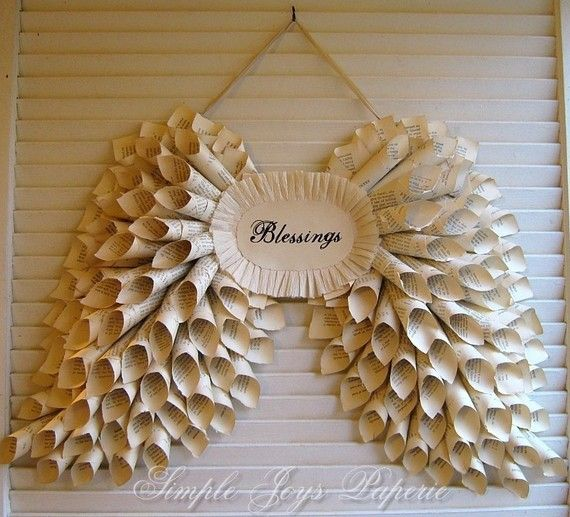 This would be pretty to do with a Christmas themed word in the middle! { Book Page Angel Wing Wreath }