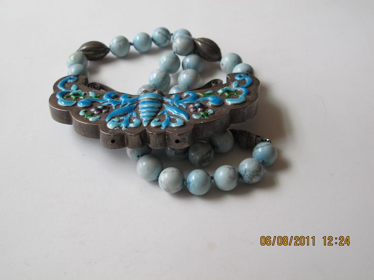 Antique Chinese silver butterfly, beautifully enameled in blues and greens, on turquoise bead necklace.