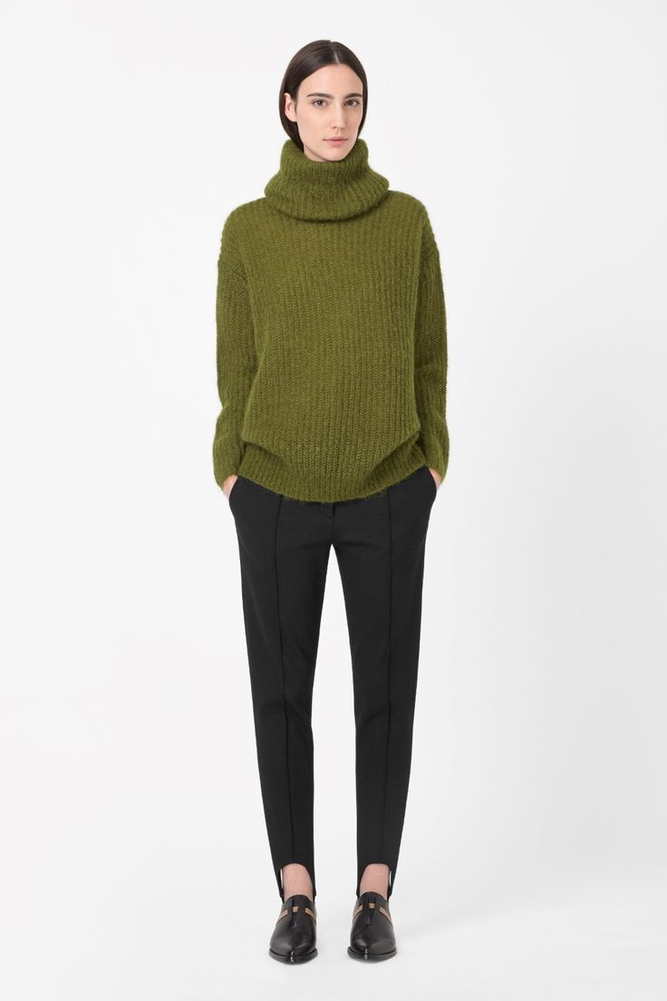 This jumper is made from a loosely knitted blend of wool and mohair with a warm fuzzy finish. A loose, oversized fit, it has dropped shoulder seams and a draped roll-neckline.